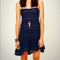Free people ruffle slip Sheer navy blue free people ruffle slip..can wear it many different ways! It moves so nice and its in great condition.  I am a top-rated seller and fast-shipper .                                       No trades. Please use the offer button to submit offers Free People Dresses