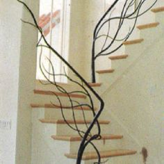Absolutely love the tree limb stair railing!