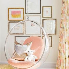 Clear Hanging Bubble Chair with Pink Chevron Cushions