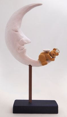 """Angel Dreams stands 11"""" tall and is our first POZY Bear vignette.  Molded from a hand carved original, each edition is cast in resin and hand paint.  Hang tag reads:  May you dream the dream of Angels embraced by the serenity of the sleeping moon.  Proudly Made in the USA!  Dealer Inquiries Welcome"""