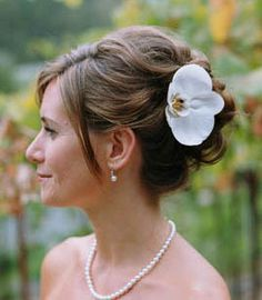 elegant side updo with flowers or accessories