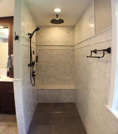 Read up on the must-know info about doorless showers—including size, material, and cost considerations—to find out if one will work in your bathroom.