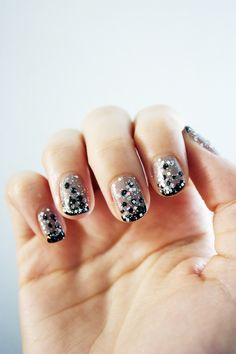 first use a bit of black (or what matches the glitter you are using)and then over the whole nail with the glitter!  Neat.