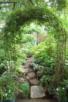 Beautiful garden arch over a pathway from pieces of an old sidewalk..