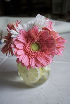 beautiful and easy gerber daisy centerpieces...would be cute for a spring/summer wedding rehearsal.
