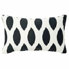 Showcasing a black and white trellis motif for eye-catching appeal, this cotton pillow adds a pop of style to your favorite chaise or arm chair.