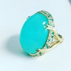 Awesome new Peruvian blue opal ring accented with Brazilian Paraiba tourmalines and diamonds.  We think the opal resembles a dragon's egg and should be worn by the Mother of Dragons on #gameofthrones.  #OhmyOMI #omiprive #opal #rings #lovegold #khaleesi #daenerys