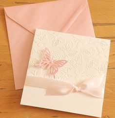 An elegant wedding invitation or christening invitation with pink ribbon and pearls . I used a high quality card stock , embossing and a beautiful butterfly. All the process is made by my hand ( emboss card, cut the paper etc.) Contact me if you need something customized. ~~~~~~~~~~~~~~ Invitation measures 13.5 X 14 cm (5 X 5.1/2 inch) when closed. The price includes black text printed inside and assorted envelope- pink pearlescent Paper I used is high quality Carta Clairefontaine 280 gs...