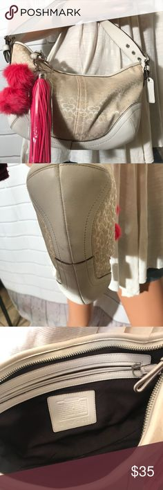 Coach cream hobo bag Brand Coach  Hobo style Signature product  Zipper closure  Include Coach hangtag  Free Pom Pom  Inside brown lining Interior zipper pocket Condition  Minor signs of wear   Thank you for looking Coach Bags Hobos