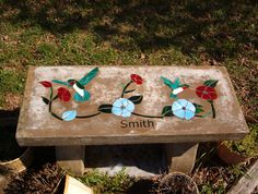 stained glass concrete bench with hummingbirds