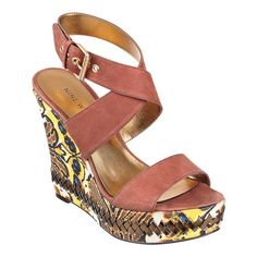 """As seen in the March issue of Real Simple.....Criss-cross platform sandal with adjustable buckle ankle strap.  Wedge and platform detailing.  Measurements: wedge 4 3/4"""" and platform 1 1/4""""/"""