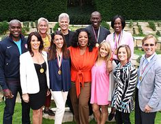Oprah Winfrey with Olympic legends