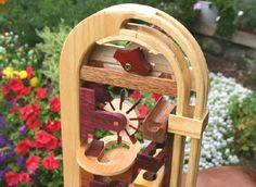 Marble games and a raceway as a woodworking plan Rolling Ball Sculpture, Woodworking Plans, Woodworking Projects, Wood Crafts, Diy And Crafts, Marble Machine, Marble Games, Simple Machines, Wood Clocks