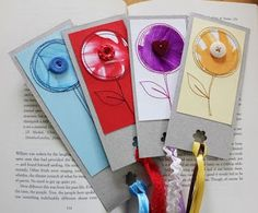 Book Marks   The middle of the flower are kids drawings! They just cut the circle out from a drawing and made a book mark