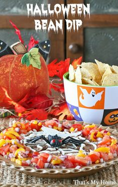 Get ready for Halloween with this tasty Halloween Bean Dip, layered with cream cheese salsa layer, cheddar cheese, guacamole and bean dip with a spider web on top.