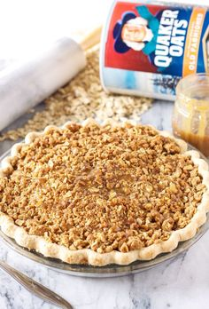 A delicious apple pie topped with an oat crumb topping and drizzled with sweet caramel sauce!