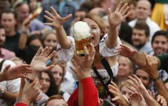 """People celebrate the opening ceremony in the """"Hofbraeuzelt' beer tent of the 180th Bavarian """"Oktoberfest"""" beer festival in Munich, southern ..."""