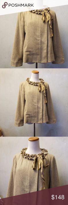 J.Crew WOOL coat in Perfect Condition like new J.Crew tan coat with a ruffled neckline and a tie. has a  small pocket inside. 100% Wool J. Crew Jackets & Coats Pea Coats