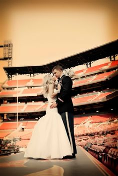 Unique Wedding photo opps on the field at Busch Stadium Photo Credit: Salvatore Cincotta Photography