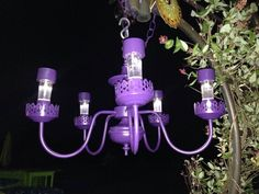 Solar lights in old fixture for purple wedding pizazz