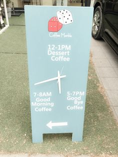 cafe.  standing signboard.   real watch.   coffee marble