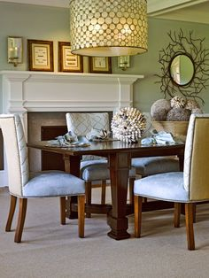 Dining - I wish those pictures were hanging, and the sconces were higher, but I love that mirror, light fixture and those chairs, not to mention those fantastic spheres!