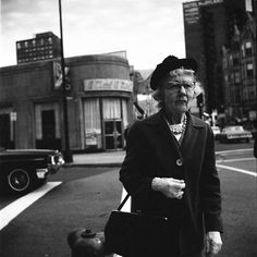 VIVIAN MAIER  Chicago (Woman on Street), 1965   For more information contact: The Jeffrey Goldstein Collection