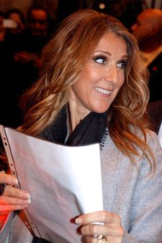 Celine Dion Photos Photos - Celine Dion happily greets and signs autographs for the large crowd of fans that greeted the singer at The Hotel Georges V, in Paris. - Celine Dion Greets Fans in Paris