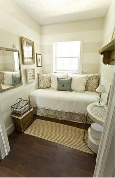 I love the settle stripes! this would be a fun little reading room!