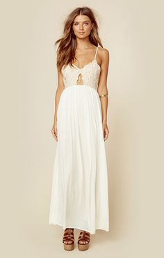 """<p class=""""product-desc-body"""">This dreamy maxi dress is Tularosa's Bryce Maxi Dress. Featuring a floral embroidered bodice with front cutout, adjustable skinny straps, and long flowing skirt. </p>  </p><ul class=""""product-desc-list""""><li>Imported</li><li>Dry Clean Only</li><li>Cotton Nylon Blend</li></ul><p class=""""product-desc-head"""">Fit Guide:</p><ul  class=""""product-desc-list""""><li>Model is 5ft 7 inches; Bust: 32"""", Waist: 24"""", Hips: 34""""</li><li>Model is wearing a size XS</li><li>Relaxed…"""