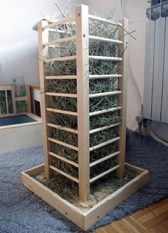Hay Tower/holder for bunnies/rabbits.  Solid birch plywood construction with Pine dowels. Wood is coated with protective non toxic food grade water based lacquer for maximum durability and longevity. Absolutely glue free construction for safe and worry free nibbling. Built for easy cleaning and maintenance. and comes fully assembled and ready to use.  Large base with integrated fence keeps the tower stable and reduces mess from hay. Diy Guinea Pig Cage, Guinea Pig House, Guinea Pigs, Rabbit Shed, Pet Rabbit, Bunny Cages, Rabbit Cages, Hay Feeder, Diy Bird Feeder