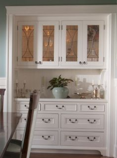 Built in dining room hutch. A great place to keep tablecloths, napkins, silver, fine china and everything else that only gets used in the dining room