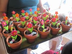 mini pots filled with dirt cake - garden theme party kids love this and it is great to have little helpers