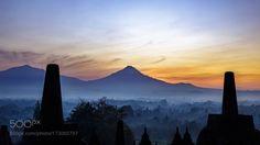 Hues and Silhouettes Mount Merapi by darrenascione  landscape sunrise nature travel volcano sun sunlight twilight temple building golden indonesia borob