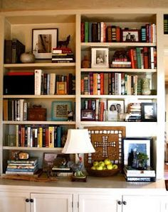 Bookcase Decor...pictures thrown in between books