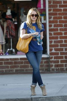 Hilary Duff, rocking a vintage tee, blue jeans and ankle boots in LA.