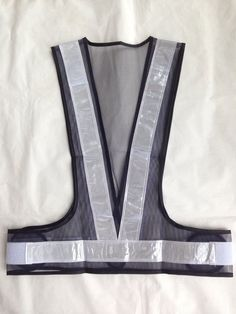 Navy color safety vest, made with white PVC reflective tape and mesh fabric.