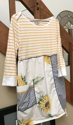 Casual & lightweight so comfortable and bright, a bit funky upcycled dress or could be worn as a tunic Top long sleeve t shirt with some stretch Bottom all cotton with a tie on the back to adjust the look Bust 19 inches lying flat Length approximately 32 inches Size