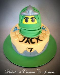 Lego ninjago birthday cake made to resemble the green ninjago and his spinner.  Both tiers are cake covered in fondant.