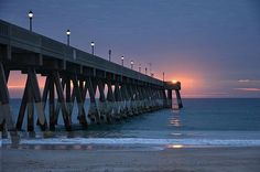 The lights on Johnnie Mercers pier at Wrightsville Beach were still on as yet another beautiful sunrise made its debut on the scene.