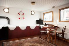 The dining space of a houseboat in Amsterdam