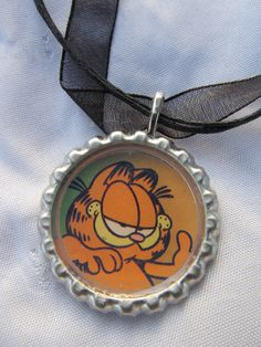Garfield cap necklace with cord. $6.99, via Etsy.