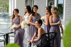 Natalie & her lovely bridal party wearing #DonnaMorgan Rachel & Laura dresses in Grey Ridge// Natalie & Brent// Toronto, Canada #greyweddings #purpleweddings #weddinginspiration #longbridesmaiddresses