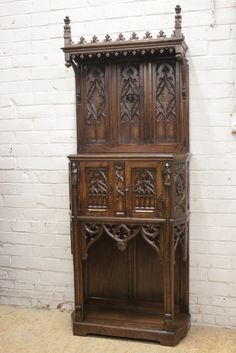 Gothic style cabinet in walnut