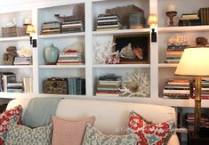 Like the sconces & stacked books. I also like look of the sofa in front of the bookcases. classic • casual • home