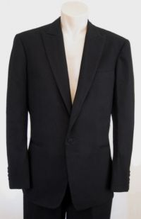 Based on the tuxedo worn by Daniel Craig in Casino Royale, this classic design features a peaked lapel, single-breasted closure and a plain back with no vents. Cashmere-silk lapels match the piping down each pant leg. James Bond Tuxedo, James Bond Casino Royale, Dinner Jacket, Tuxedo Wedding, Online Shopping Clothes, Custom Shirts, Cashmere, Vintage Outfits, Suit Jacket