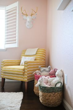 This seating area in a little girl's room is too cute! The yellow 9 by Novogratz chair is chic, yet oh-so-fun!