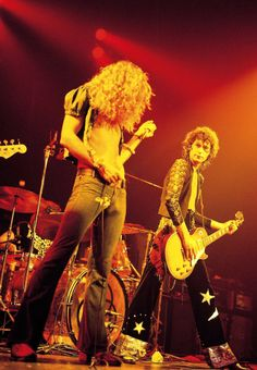 babeimgonnaleaveu:   Robert Plant and Jimmy Page on stage at Madison Square Garden, 1973.