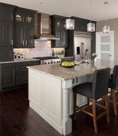 Inspiration For A Large Transitional Galley Eat In Kitchen With An Undermount Sink Raised Panel Cabinets Gray Matchstick Tile Backsplash