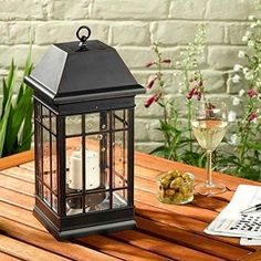 Smart Solar San Rafael II Solar Mission Lantern Illuminated by 2 High Performance Warm White LEDs In The Top and One Amber LED in the Pillar Candle Outdoor Solar Lanterns, Solar Powered Lanterns, Solar Lights, Outdoor Lighting, Outdoor Decor, Outdoor Ideas, Lighting Ideas, Outdoor Spaces, Patio Ideas